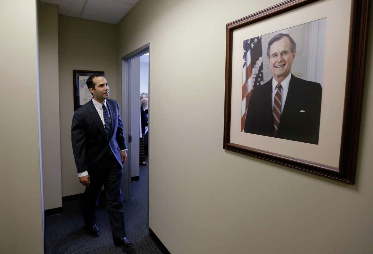 George P. Bush meets the gaze of his grandfather George H.W. Bush on Tuesday during his visit to the Republican Party of Texas headquarters to formally file to run for Texas land commissioner.
