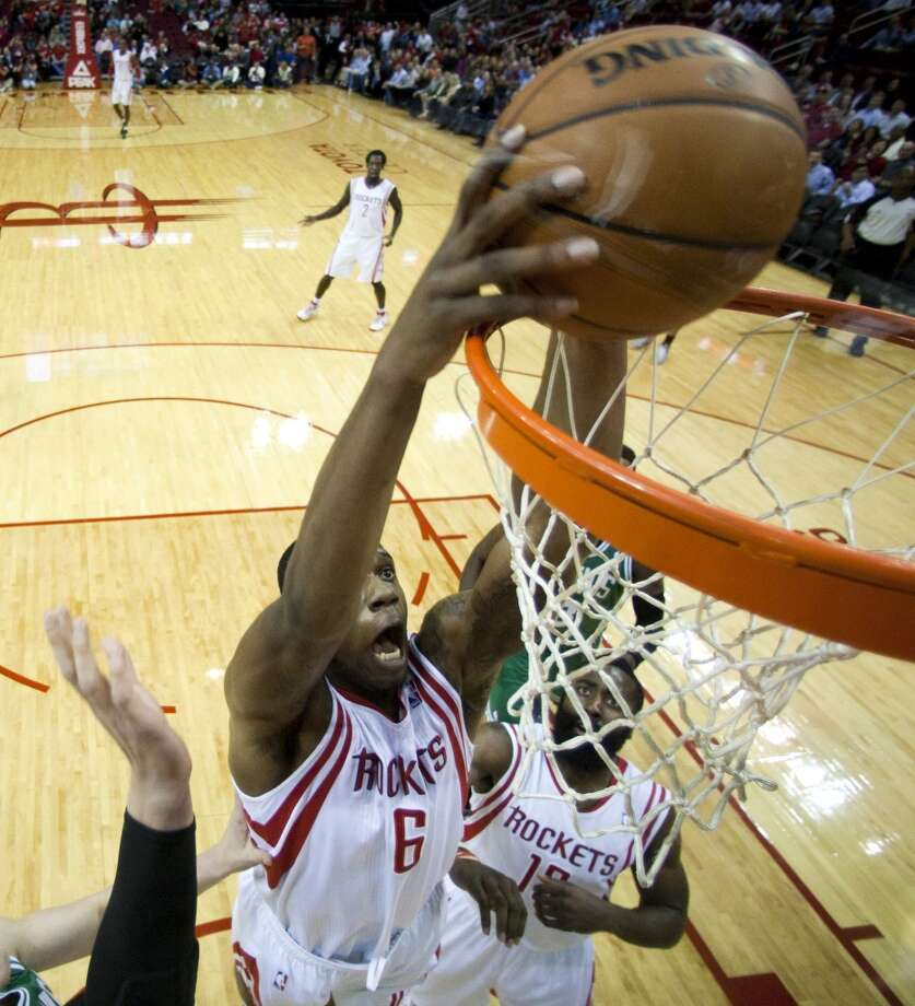 Nov. 19: Rockets 109, Celtics 85   Rockets forward Terrence Jones slams a dunk home against the Celtics. Photo: Brett Coomer, Houston Chronicle
