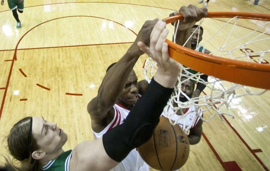 Rockets forward Terrence Jones slams a dunk home against the Celtics. Photo: Brett Coomer, Houston Chronicle