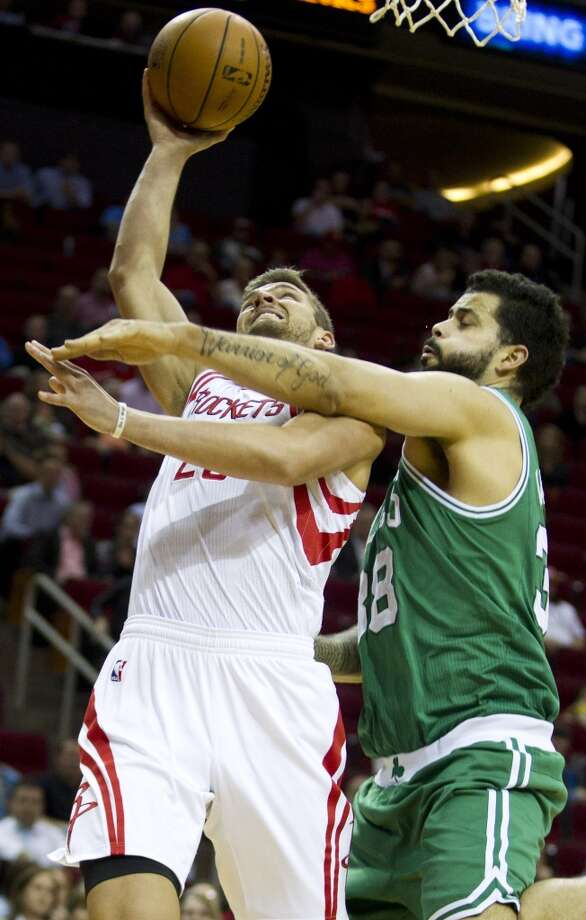 Vitor Faverani of the Celtics defends Rockets forward Chandler Parsons. Photo: Brett Coomer, Houston Chronicle