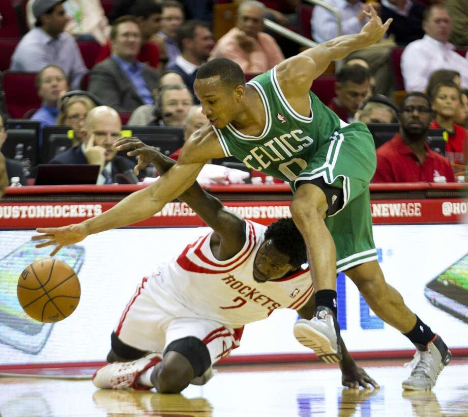 Avery Bradley of the Celtics and Patrick Beverley of the Rockets fight for possession. Photo: Brett Coomer, Houston Chronicle