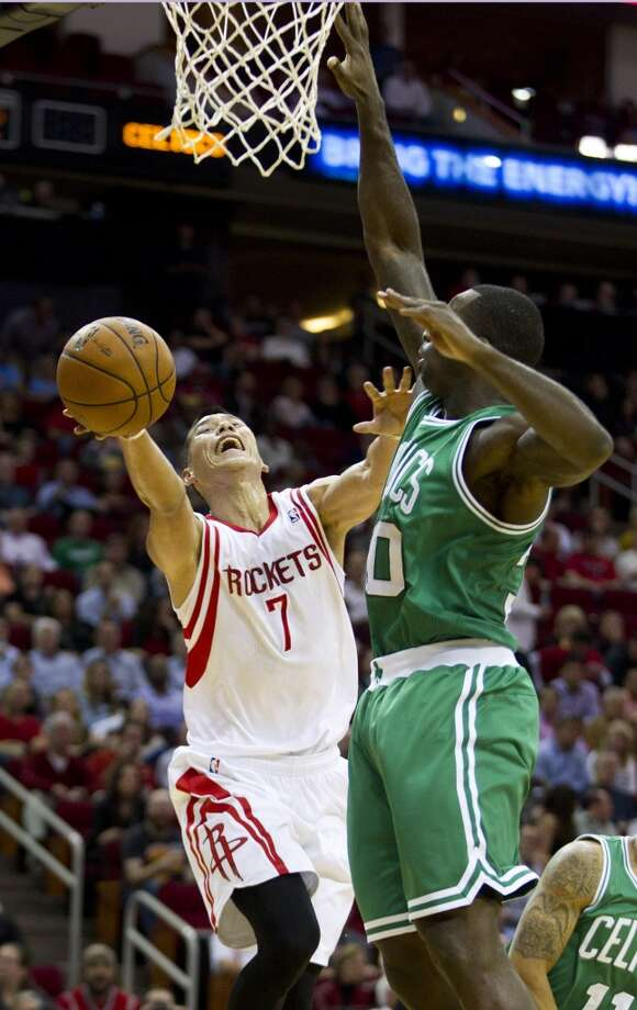 Jeremy Lin of the Rockets is defended by Celtics forward Brandon Bass. Photo: Brett Coomer, Houston Chronicle