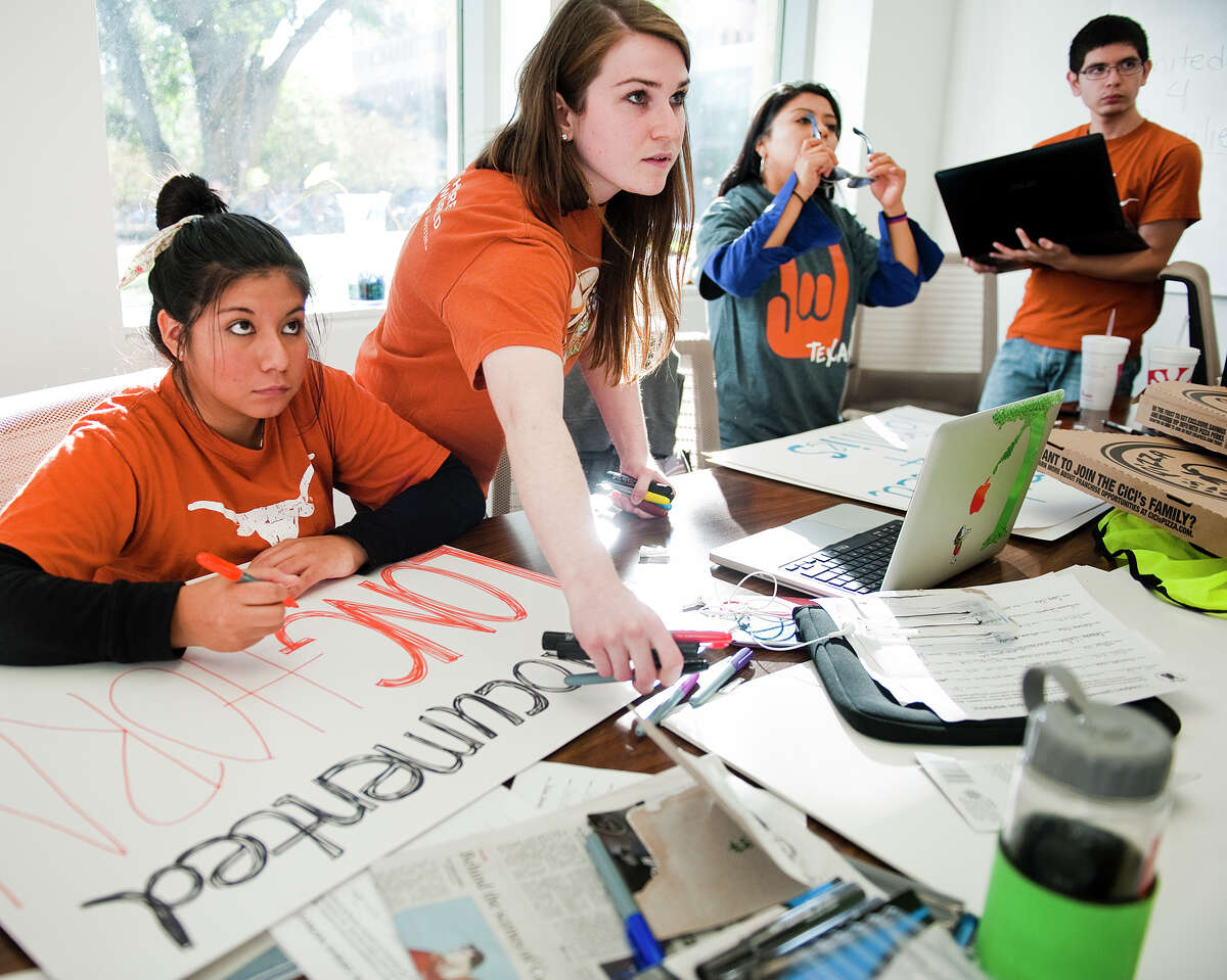 UT's University Leadership Initiative still plans to hold a demonstration Wednesday against a campus group's now-canceled immigrant game. From left are Anayeli Marcos of Houston, Erin Formby of Fort Worth, Edilsa Lopez of Guatemala and Heriberto Perez of Pharr.
