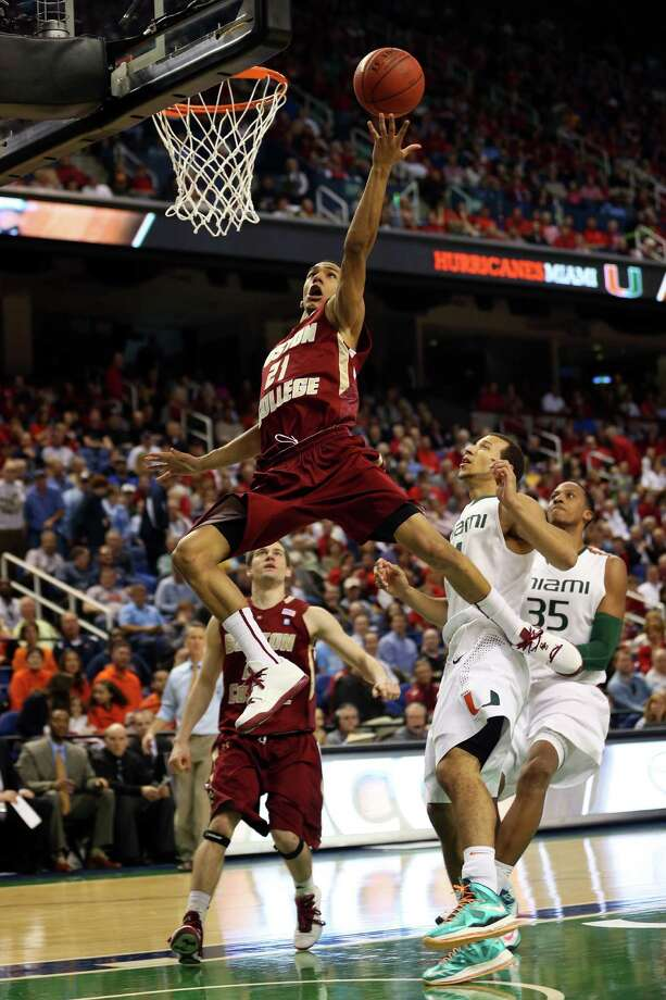 GREENSBORO, NC - MARCH 15:  Olivier Hanlan #21 of the Boston College Eagles goes to the basket against the Miami Hurricanes during the quarterfinals of the ACC Men's Basketball Tournament at the Greensboro Coliseum on March 15, 2013 in Greensboro, North Carolina.  (Photo by Streeter Lecka/Getty Images)  *** BESTPIX *** Photo: Streeter Lecka, Getty Images / 2013 Getty Images