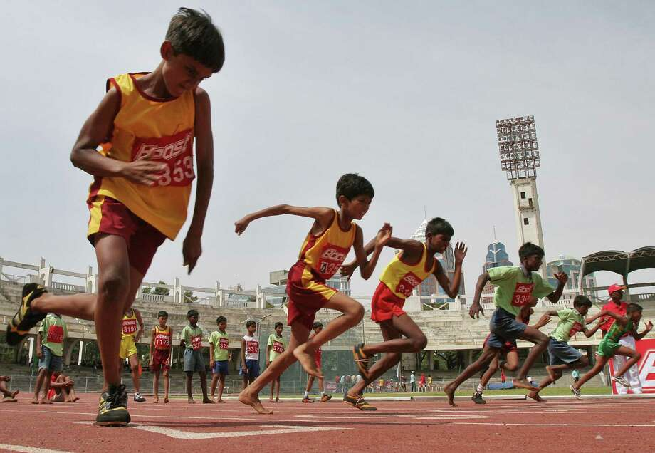 Boys race in a World Athletics Day meet in Bangalore, India, in 2007. Researchers have found that children now are about 15 percent less fit than their parents were. Photo: Associated Press File Photo