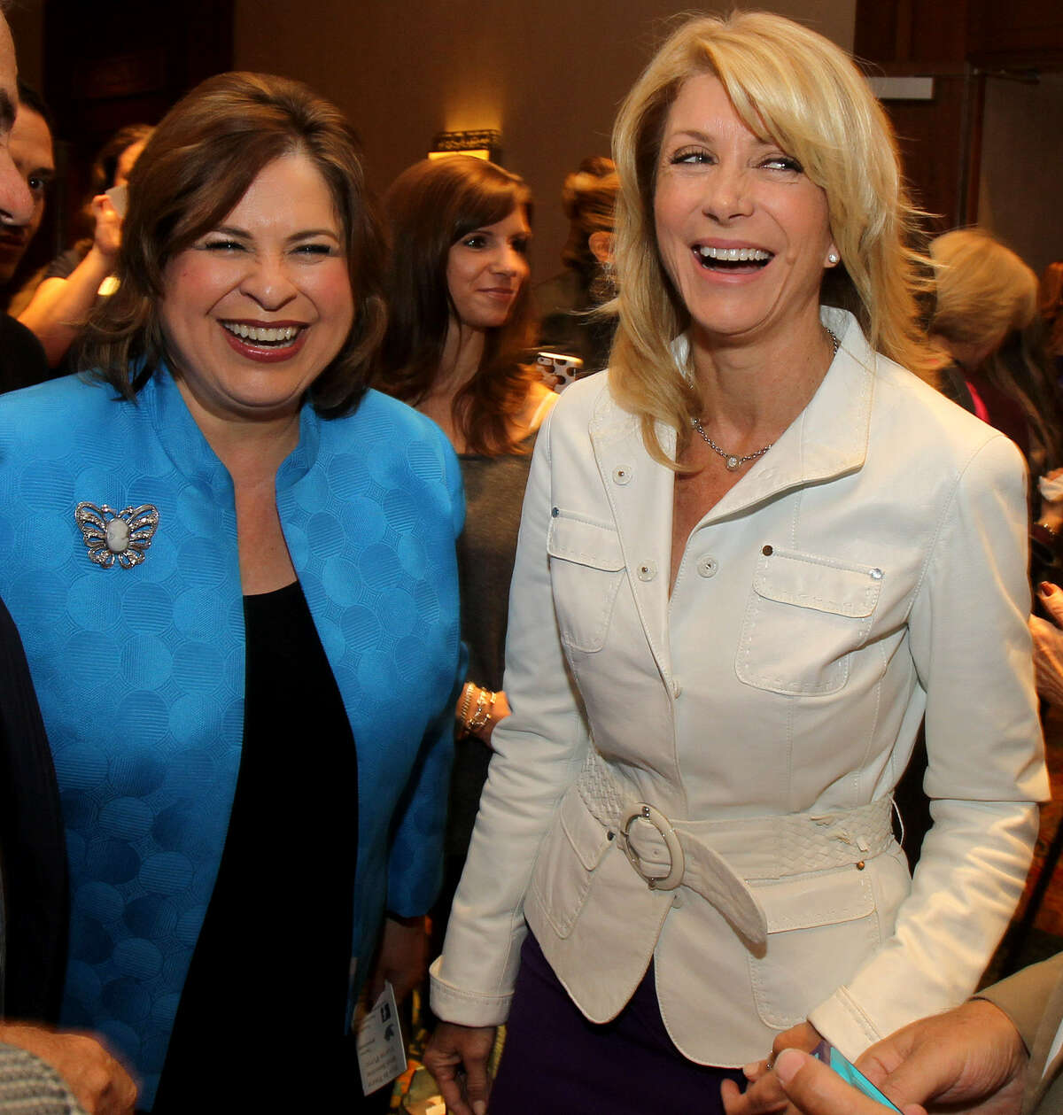 State Sen. Leticia Van de Putte rushed off a Houston stage Thursday evening to assist a woman who had fainted during a speech by state Sen. Wendy Davis. Get to know Leticia Van de Putte.Van de Putte (left) and Davis greeted supporters at a luncheon in San Antonio earlier this month.