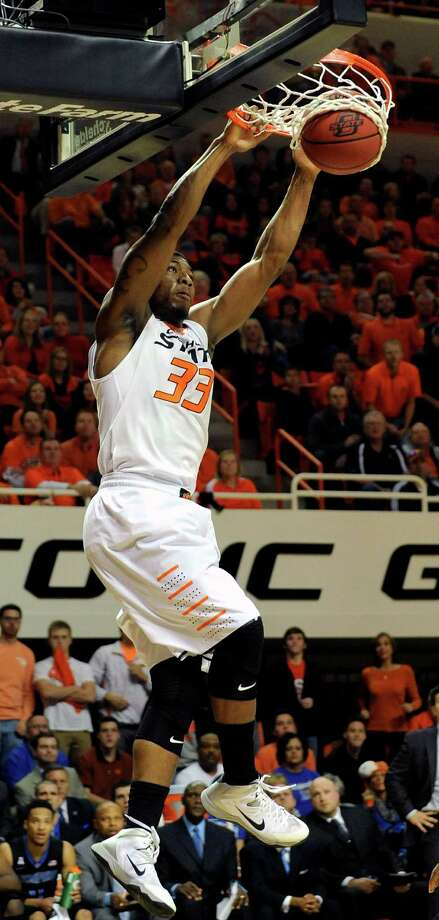 Oklahoma State guard Marcus Smart dunks the basketball during the first half of an NCAA college basketball game in Stillwater, Okla., Tuesday, Nov. 19, 2013.  (AP Photo/Brody Schmidt) ORG XMIT: OKBS102 Photo: BRODY SCHMIDT / FR79308 AP