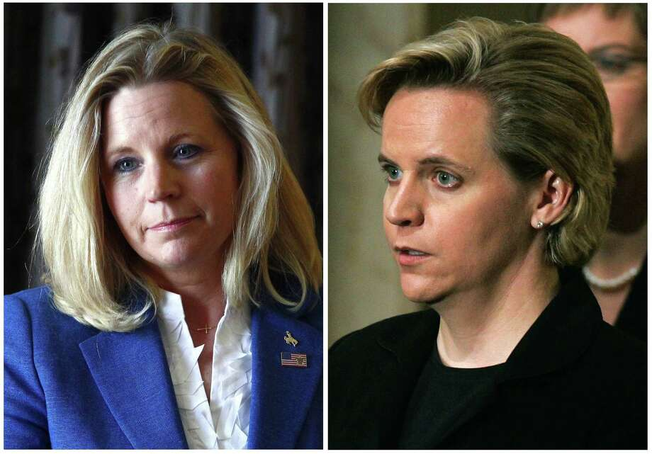 Liz Cheney (left) opposes legalized gay marriages such as the one between her sister, Mary (right), and Heather Poe. Photo: Associated Press