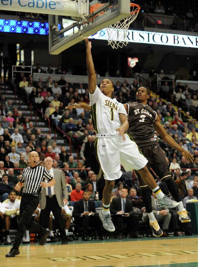 Siena's Marquis Wright goes in for a score during their men's college basketball game against St. Bonaventure at the Times Union Center on Tuesday Nov. 19, 2013 in Albany, N.Y. (Michael P. Farrell/Times Union) Photo: Michael P. Farrell / 00024676A