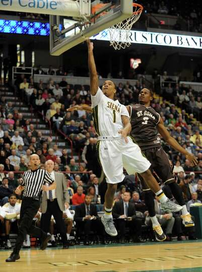 Siena's Marquis Wright goes in for a score during their men's college basketball game against St. Bo