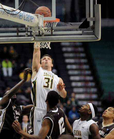Siena's Brett Bisping goes in for a score during their men's college basketball game against St. Bon