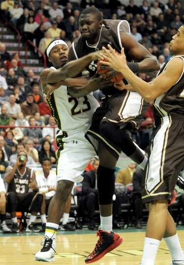 Siena's Maurice White and St. Bonaventure Youssou Ndoye battle for a rebond during their men's colle