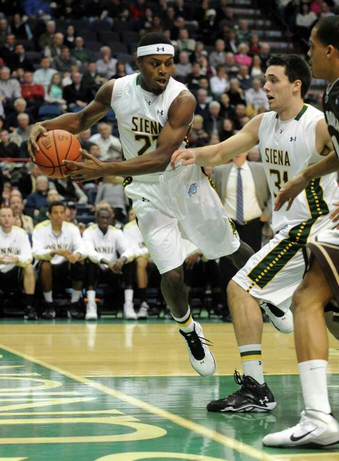 Siena's Maurice White captures a rebound during their men's college basketball game against St. Bonaventure at the Times Union Center on Tuesday Nov. 19, 2013 in Albany, N.Y. (Michael P. Farrell/Times Union) Photo: Michael P. Farrell / 00024676A