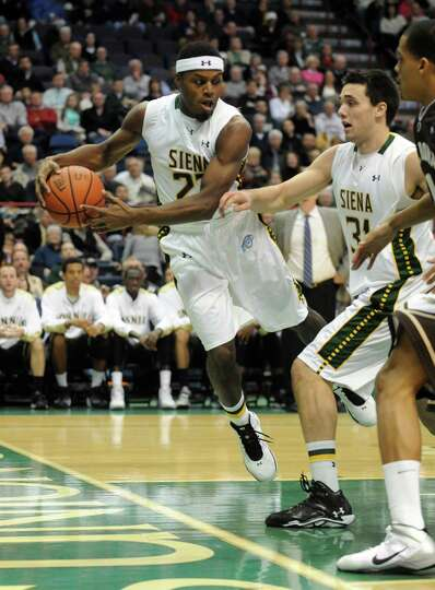 Siena's Maurice White captures a rebound during their men's college basketball game against St. Bona