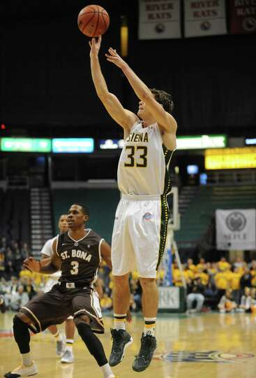 Siena's Rob Poole puts up a 3pt shot during their men's college basketball game against St. Bonavent