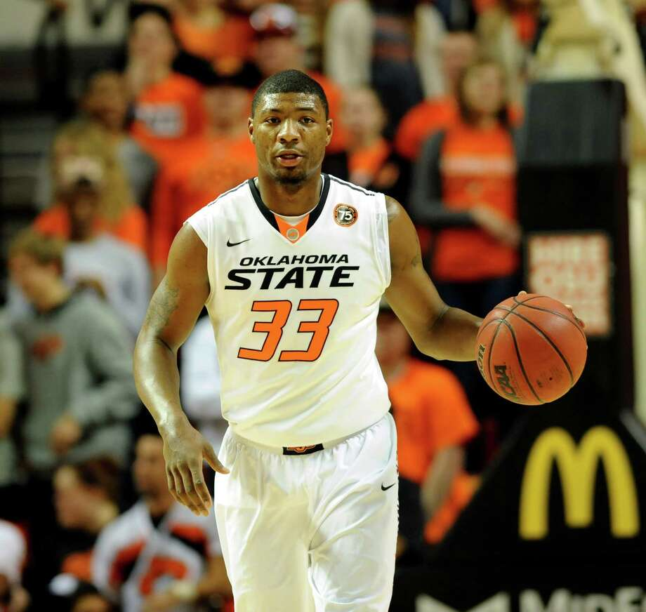 Oklahoma State guard Marcus Smart brings the ball up during the first half of an NCAA college basketball game in Stillwater, Okla., Friday, Nov. 15, 2013. Smart scored 16 points in the 97-63 win over Arkansas-Pine Bluff. (AP Photo/Brody Schmidt) Photo: BRODY SCHMIDT, FRE / FR79308 AP