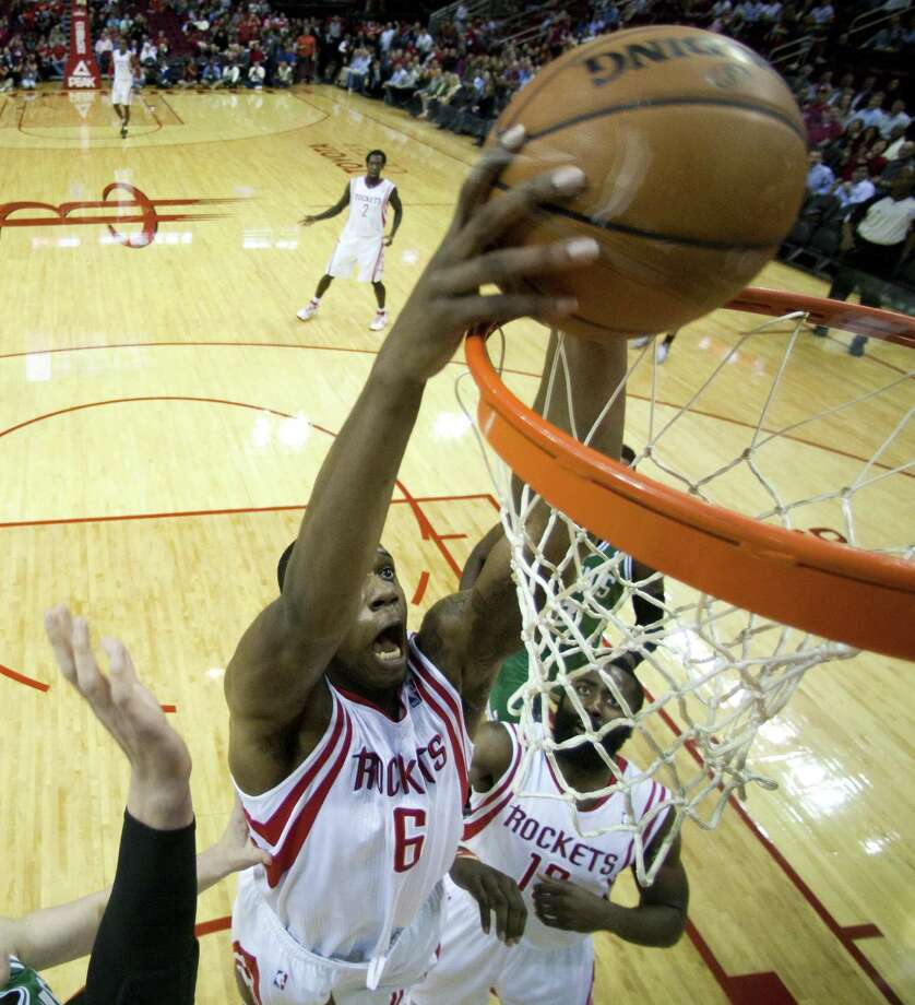 Houston power forward Terrence Jones, who had a career-high 24 points with nine rebounds and two blocks, dunks against Boston at the Toyota Center. Photo: Brett Coomer / Houston Chronicle