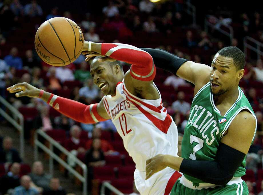 A collision between Dwight Howard, left, and Celtics forward Jared Sullinger was one of the few rough moments the Rockets experienced Tuesday night en route to their easiest victory of the season. Photo: Brett Coomer, Staff / © 2013 Houston Chronicle