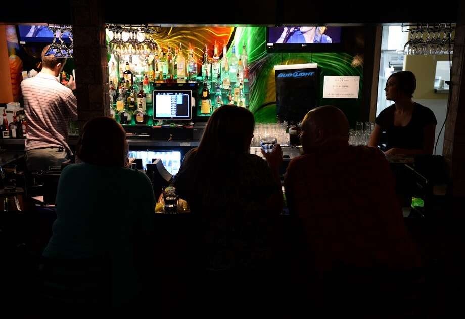 Patrons enjoy a few drinks and friends at the French Quarter Bar & Grill in Vidor on Wednesday. Photo taken Wednesday, November 06, 2013 Guiseppe Barranco/@spotnewsshooter