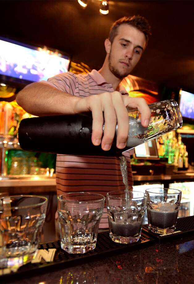 Justin Dunkin pours drinks for guests at the French Quarter Bar & Grill in Vidor on Wednesday. Photo taken Wednesday, November 06, 2013 Guiseppe Barranco/@spotnewsshooter