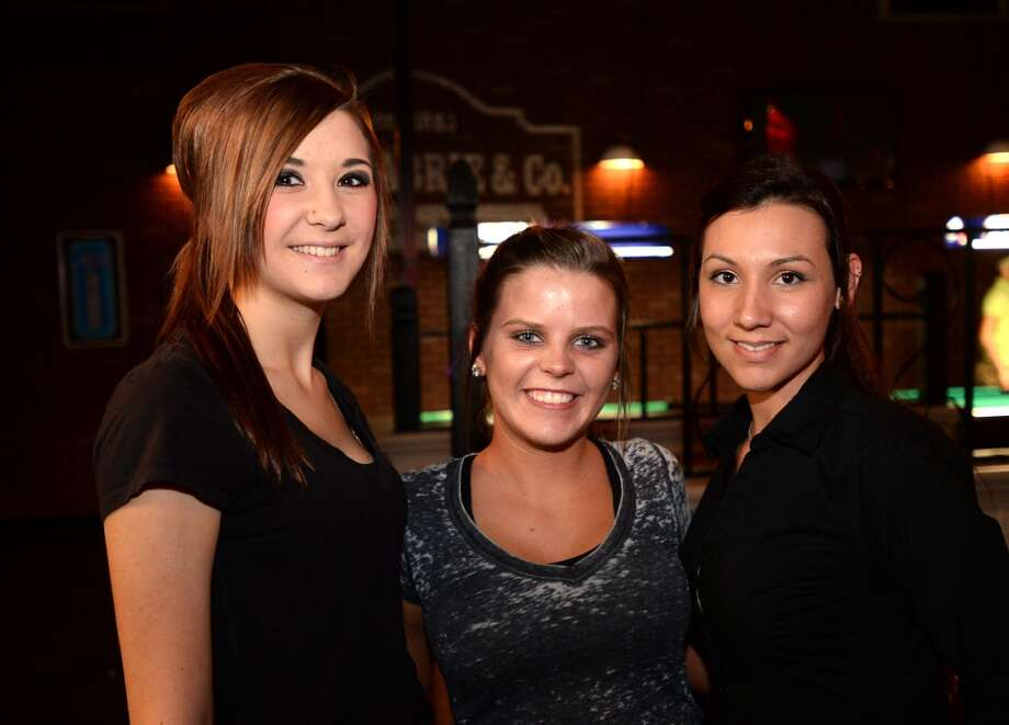 Waitresses Hope Brown, Morgan Lee and Christina Wiggins at the French Quarter Bar & Grill in Vidor on Wednesday. Photo taken Wednesday, November 06, 2013 Guiseppe Barranco/@spotnewsshooter