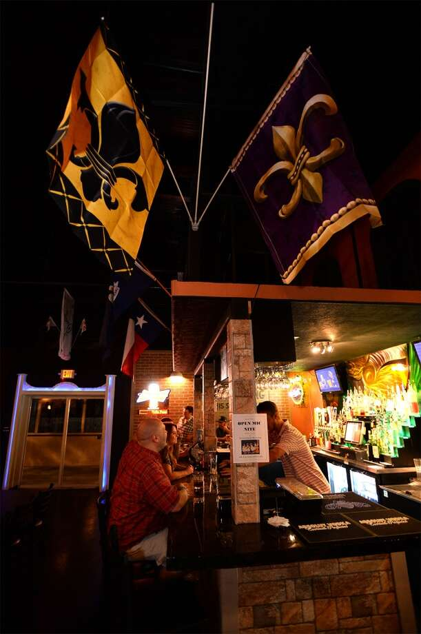 flour de lee flags at the French Quarter Bar & Grill in Vidor on Wednesday. Photo taken Wednesday, November 06, 2013 Guiseppe Barranco/@spotnewsshooter