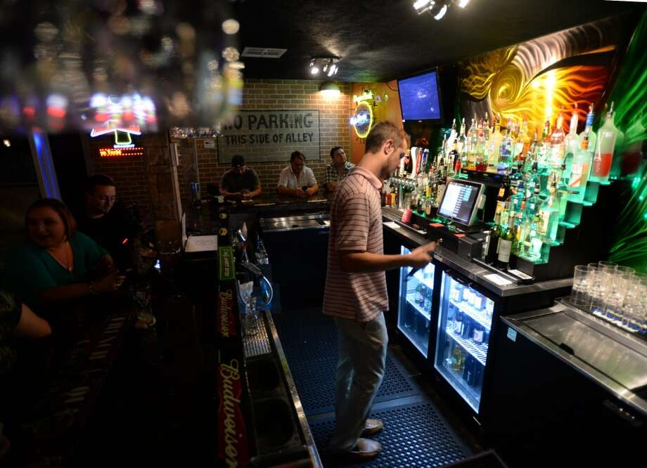 Justin Dunkin tends bar at the French Quarter Bar & Grill in Vidor on Wednesday. Photo taken Wednesday, November 06, 2013 Guiseppe Barranco/@spotnewsshooter