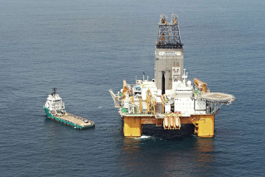 The Deepsea Stavanger Drilling Rig operates with a support vessel in Angola, Africa. Photo: BP