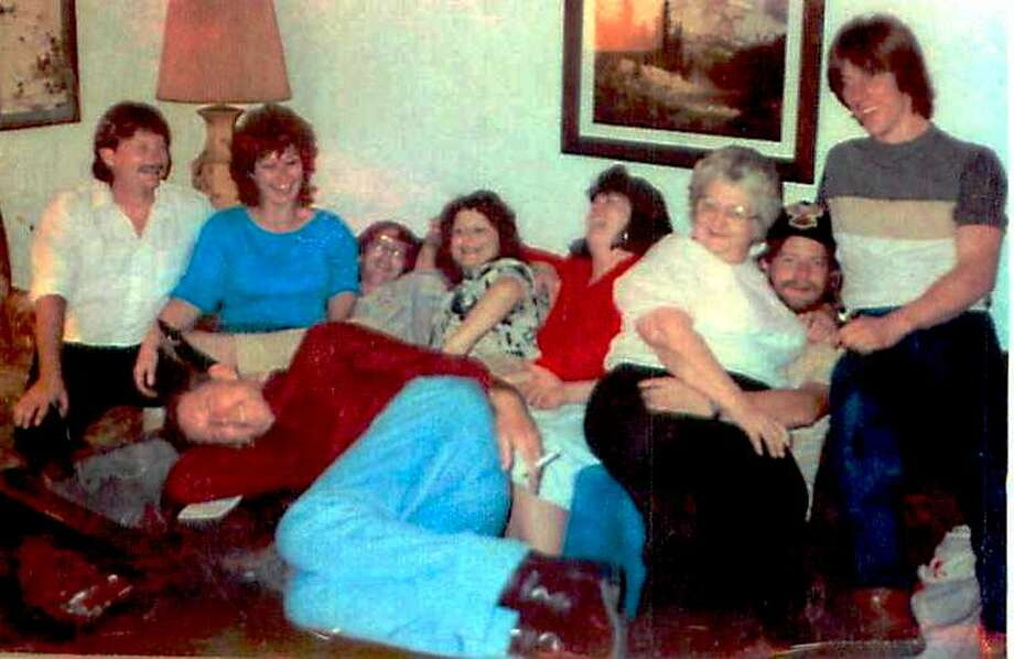Love love love this picture of my brothers and sisters clowning with our departed Mom and Dad. Silly but sooo fun!!  Susan Redd