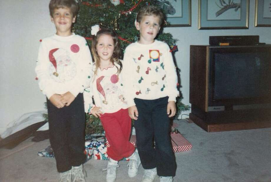 My brothers and I in our awesome christmas sweaters made by Grandma and high tops. We would compete to see who would wake up first on christmas morning. Still our favorite time of year :) Good ol' '80's Christmas!  Tara Block