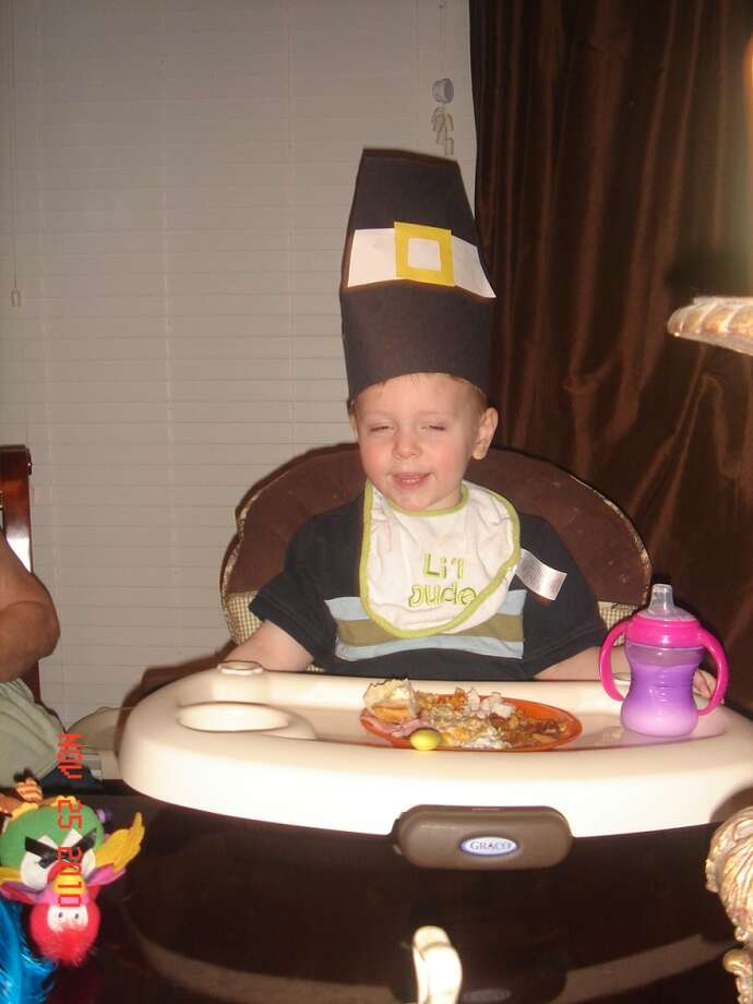 "My grandson, Trevor proudly wears his ""Papal Pilgrm Hat"" he made in Day-Care for the November 2010 Thanksgiving Festivities. Who knows maybe Pope Francis will pop in and bless his sippy cup!  Elizabeth Klotter"