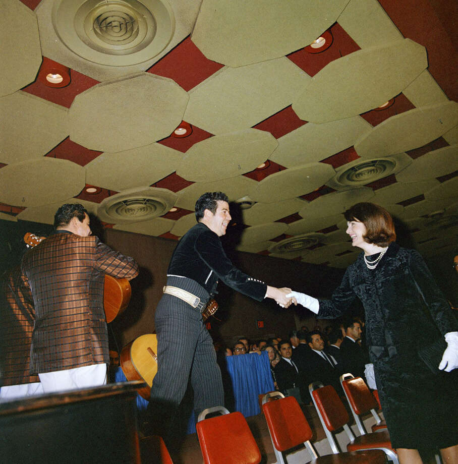 Fernando Herrera shakes Jackie Kennedy's hand a day before JFK's slaying.