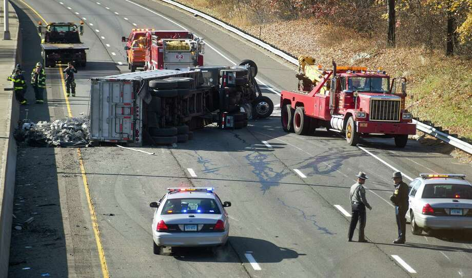 An accident involving a semi-truck closed the southbound side of I-95 and caused serious delays on the northbound side on Wednesday, November 20, 2013. The truck jack-knifed as a result of the accident and spilled its metal contents on the road. Photo: Lindsay Perry / Stamford Advocate