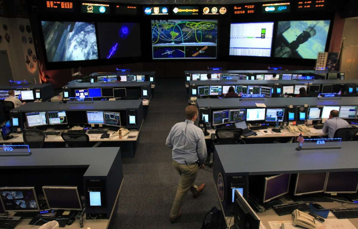The flight path of International Space Station (ISS) can be seen on the screen as Flight Director Ed Van Cise supports ISS from Mission Control at Johnson Space Center on Tuesday, Nov. 19, 2013, in Houston. The International Space Station has been in operation for more than 15 years. ( Mayra Beltran / Houston Chronicle ) HoustonChronicle.com: Future up in the air as space station turns 15