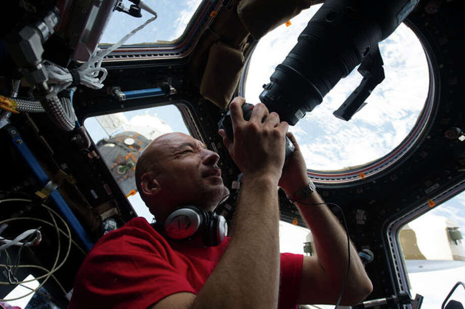 Inside the Cupola, European Space Agency astronaut Luca Parmitano, an Expedition 36 flight engineer, eyeballs a point on Earth some 250 miles below him and the International Space Station before pinpointing a specific photo target of opportunity.  HoustonChronicle.com: Future up in the air as space station turns 15 Photo: NASA