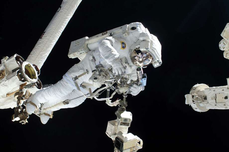 July 9, 2013: Anchored to a Canadarm2 mobile foot restraint, European Space Agency astronaut Luca Parmitano, Expedition 36 flight engineer, participates in a session of extravehicular activity (EVA) as work continues on the International Space Station. During the six-hour, seven-minute spacewalk, Parmitano and NASA astronaut Chris Cassidy (out of frame), flight engineer, prepared the space station for a new Russian module and performed additional installations on the station's backbone. Photo: NASA