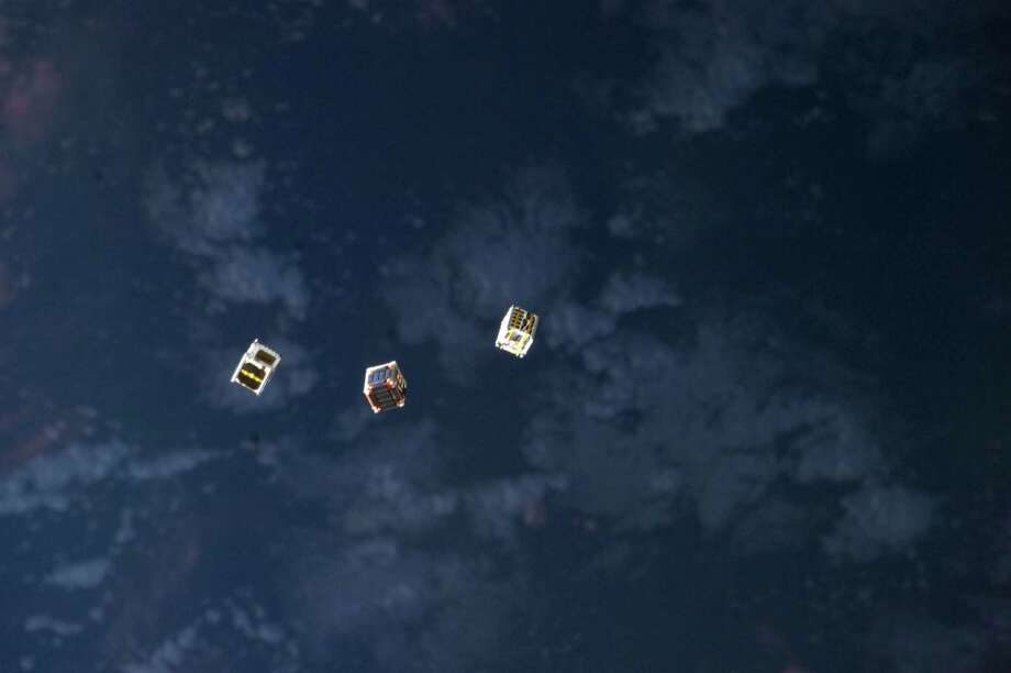 Oct. 4, 2012 — Several tiny satellites are featured in this image photographed by an Expedition 33 crew member on the International Space Station. The satellites were released outside the Kibo laboratory using a Small Satellite Orbital Deployer attached to the Japanese module's robotic arm on Oct. 4, 2012. Japan Aerospace Exploration Agency astronaut Aki Hoshide, flight engineer, set up the satellite deployment gear inside the lab and placed it in the Kibo airlock. The Japanese robotic arm then grappled the deployment system and its satellites from the airlock for deployment. Photo: NASA