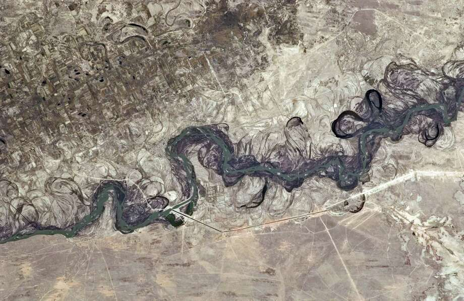 Sept.30,  2010 —  Syr Dar'ya River floodplain in Kazakhstan, central Asia is featured in this image photographed by an Expedition 25 crew member on the International Space Station. Central Asia's most important cotton-growing region is concentrated in the floodplain of the Syr Dar'ya, and is irrigated by water from the river. Photo: NASA