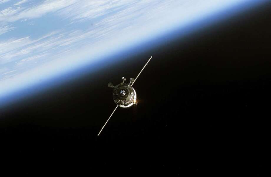 June 11, 2003 — Backdropped by the blackness of space and Earth's horizon, an unmanned Progress supply vehicle approaches the Pirs Docking Compartment (out of frame) attached to the Zvezda Service Module on the International Space Station (ISS), completing a three-day automated flight. The Progress 11 resupply craft, which launched from the Baikonur Cosmodrome in Kazakhstan on June 8, 2003, carried more than two tons of food, fuel, water, supplies and scientific gear for the Expedition 7 crew aboard the Station. The Progress linked up with the ISS at 6:15 a.m. (CDT) on June 11, 2003. Photo: NASA