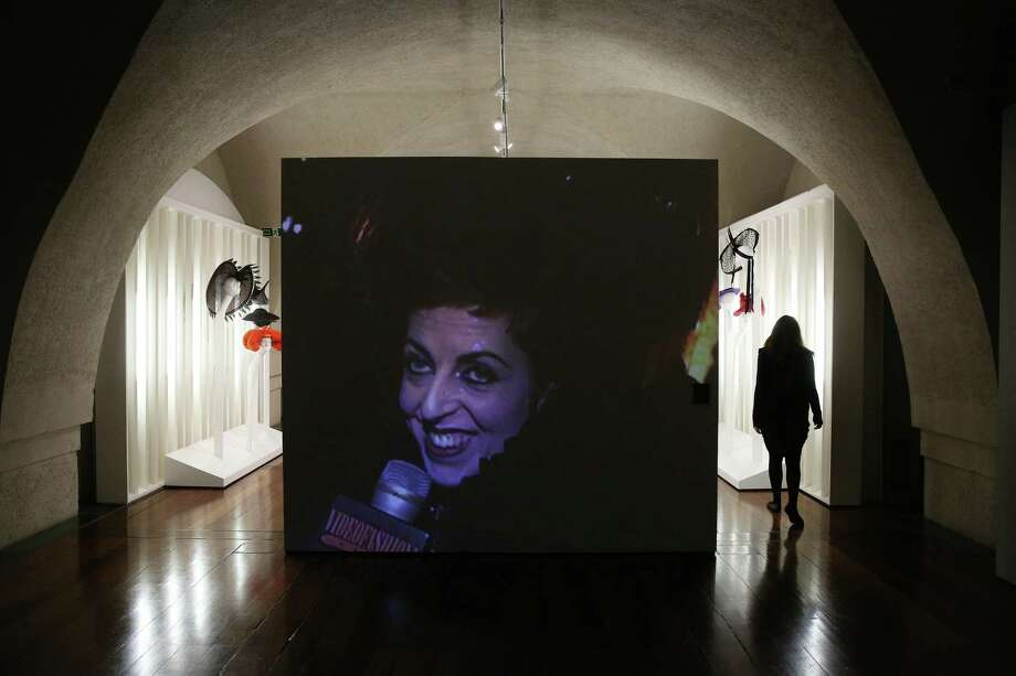 """A video screen shows an image of Isabella Blow at the """"Isabella Blow: Fashion Galore!"""" exhibition at Somerset House in London.  The show features more than 100 garments from designers such as Alexander McQueen and Philip Treacy. Photo: Photos By Peter Macdiarmid / Getty Images For Somerset House"""
