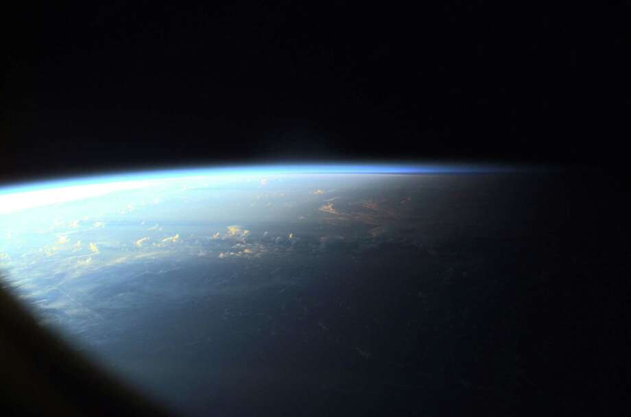 June 2, 2001 — Earth's limb at sunset as photographed by one of the Expedition Two crew members with a digital still camera aimed through the nadir window of the U.S. laboratory Destiny. Photo: NASA