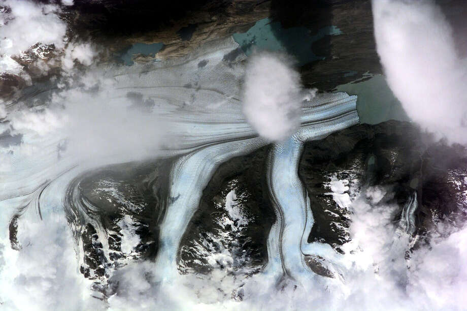 December 18, 2000 — The Upsala Glacier in Argentina was featured in this image photographed by an Expedition One crewmember onboard the International Space Station (ISS). This is the third largest glacier of the Southern Patagonian Ice Field with an estimated area of over 800 square kilometers. This long, north-south oriented river of ice terminates in the northern arm of Lake Argentino. This same area was photographed during the eighth expedition of the International Space Station just over 3 years later; reference photo no. ISS008-E-11807 under the Expedition 8 section of the Human Space Flight website. Photo: NASA