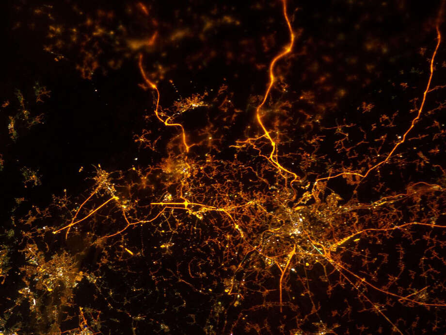 "Dec. 8, 2012 — A nighttime view of Liege, Belgium is featured in this image photographed by an Expedition 34 crew member on the International Space Station. To paraphrase the old expression, ""all roads lead to Liege"" – or at least one could get that impression from this nighttime photograph. The brightly lit core of the Liege urban area appears to lie at the center of a network of roadways—traceable by continuous orange lighting—extending outwards into the rural, and relatively dark, Belgium countryside. For a sense of scale the distance from left to right is approximately 70 kilometers. The region at upper left to the southeast of Verviers includes agricultural fields and forest; hence it appears almost uniformly dark at night. The image was taken using the European Space Agency's Nodding mechanism, also known as the NightPod. NightPod is an electro-mechanical mount system designed to compensate digital cameras for the motion of the space station relative to Earth. The primary mission goal was to take high-resolution, long exposure digital imagery of Earth from the station's Cupola, particularly cities at night. While the official NightPod mission has been completed, the mechanism remains onboard for crew members to use. Liege is the third most populous metropolitan region in Belgium (after Brussels and Antwerp); it includes 52 municipalities, including the nearby city of Seraing. Photo: NASA"