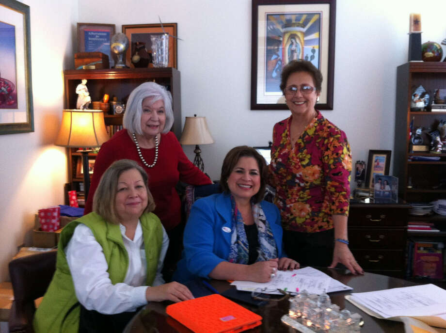 State Sen. Leticia Van de Putte (third from left) signs paperwork to join the Alamo Couriers chapter of the Daughters of the Republic of Texas. With her are (from left) Mary Ann Oliver, chapter registrar; Martha Fleitas, chapter president; and Armandina Sifuentes, member. Photo: Courtesy Photo