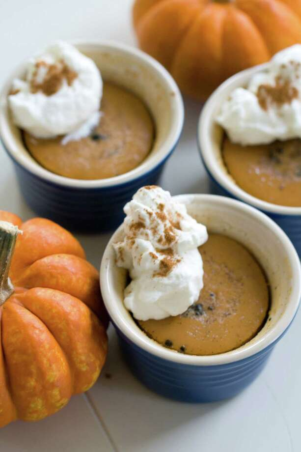 Thai pumpkin custard is an unexpected twist on traditional pumpkin pie. And a cup of canned pumpkin has just 80 calories. (AP Photo/Matthew Mead) ORG XMIT: MER2013111110364085 Photo: Matthew Mead / FR170582 AP