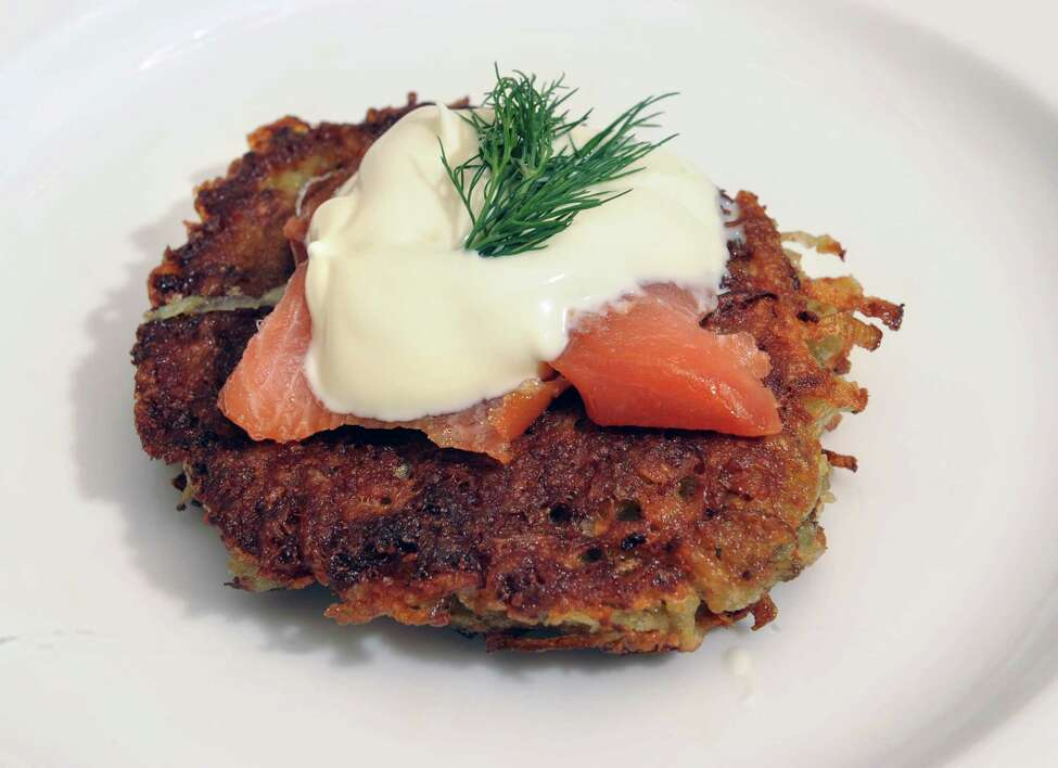 Henry's potato latke with a Wolfgang Puck twist including smoked salmon and creme fraiche on Friday, Nov. 1, 2013 in Loudonville, N.Y. Stacey Morris and her boyfriend Bill Duckman will be cooking this for a Thanksgiving dinner that incorporates both Christian and Jewish traditions. (Lori Van Buren / Times Union)
