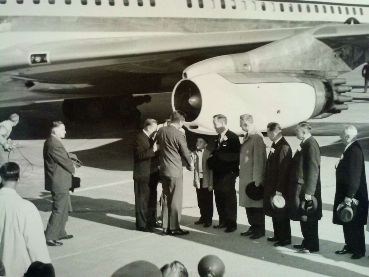 Kennedy at receiving line at airport shaking hands with Albert D. Rosellini, Jr., son of Washington's governor Nov. 16, 1961. Others, left to right, U.S. Sen. Henry