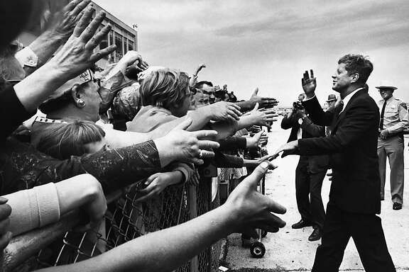 **FILE** President John F. Kennedy is greeted by supporters in Pierre, S.D., as he arrives on Aug. 19, 1962,  to inspect a new dam. Nov. 22, 2013 marks the 50th anniversary of the assassination of President Kennedy. (George Tames/The New York Times)