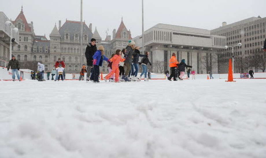 Adults and children skate on the ice skating rink at the Empire State Plaza on Sunday, March 3, 2013 in Albany, NY.  Sunday was the final day the skating rink would be open this season.  (Paul Buckowski / Times Union) Photo: Paul Buckowski / 10021364A