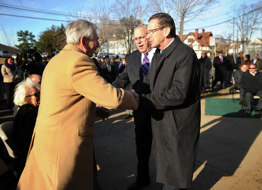 Ernie Trefz, left, is greeted by Governor Dannel P. Malloy at the groundbreaking for the Ernest C. Trefz School of Business at the University of Bridgeport in Bridgeport, Conn. on Wednesday, November 20, 2013. With Malloy is University President Neil Salonen. Photo: Brian A. Pounds / Connecticut Post